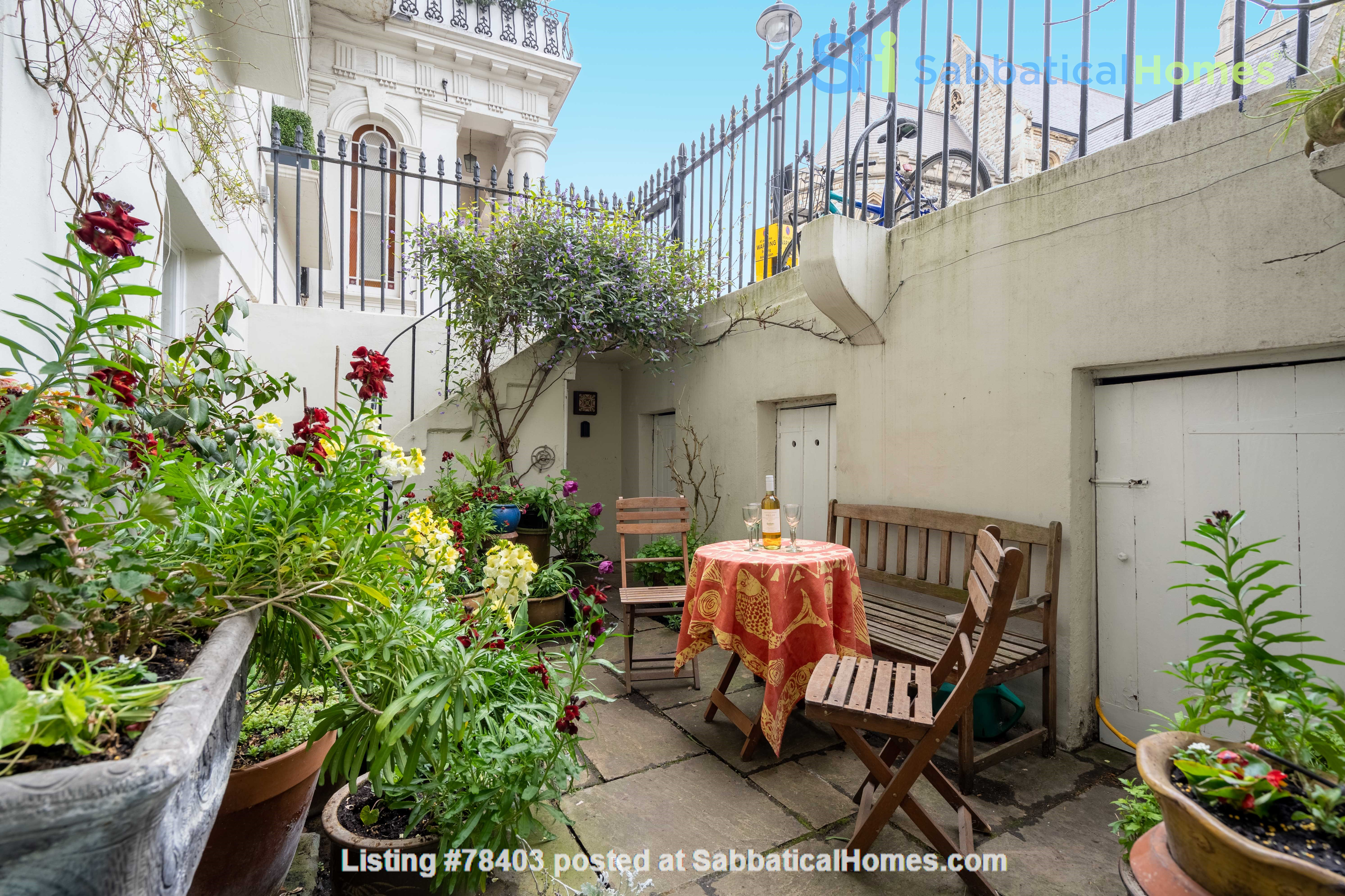 Notting Hill  Garden Flat- Antiques, Books , Textiles & Characterful Home Rental in Greater London, England, United Kingdom 0