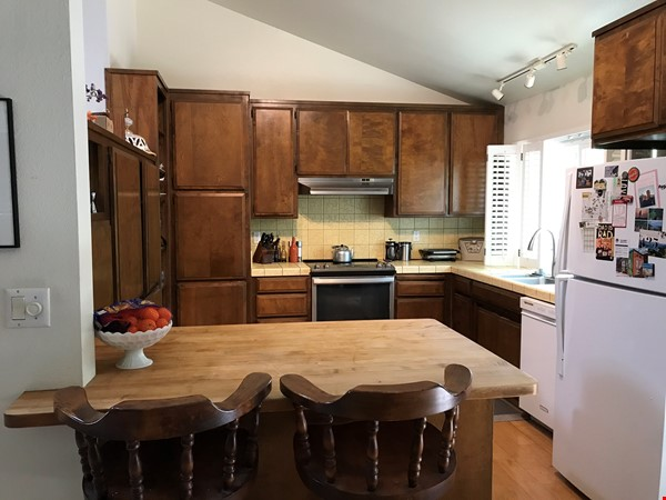 Unique 1 Br/2 Ba plus Den/Guest Rm With Wrap Around Yard - Fully Furnished Home Rental in Davis 3 - thumbnail