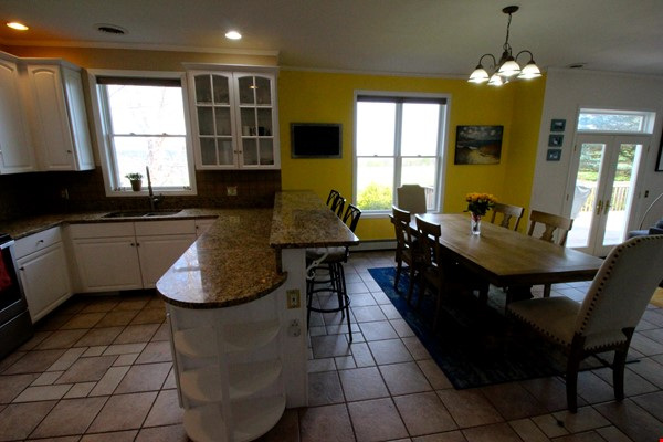 Beautiful FURNISHED large home (5 BDR, 4 BATH)  with in-home gym, playground, expansive views, spacious grounds, Close to both Cayuga Med and Cornell University Home Rental in Ithaca 9 - thumbnail