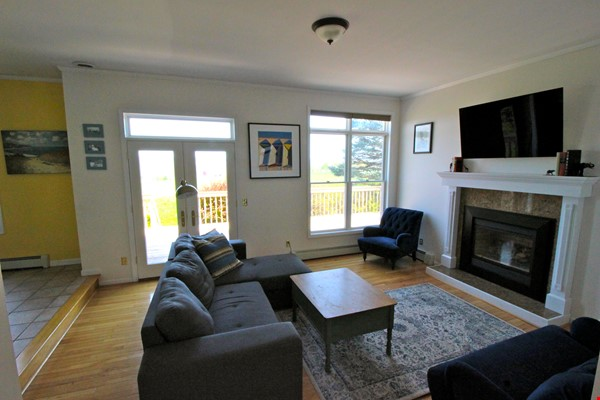Beautiful FURNISHED large home (5 BDR, 4 BATH)  with in-home gym, playground, expansive views, spacious grounds, Close to both Cayuga Med and Cornell University Home Rental in Ithaca 7 - thumbnail