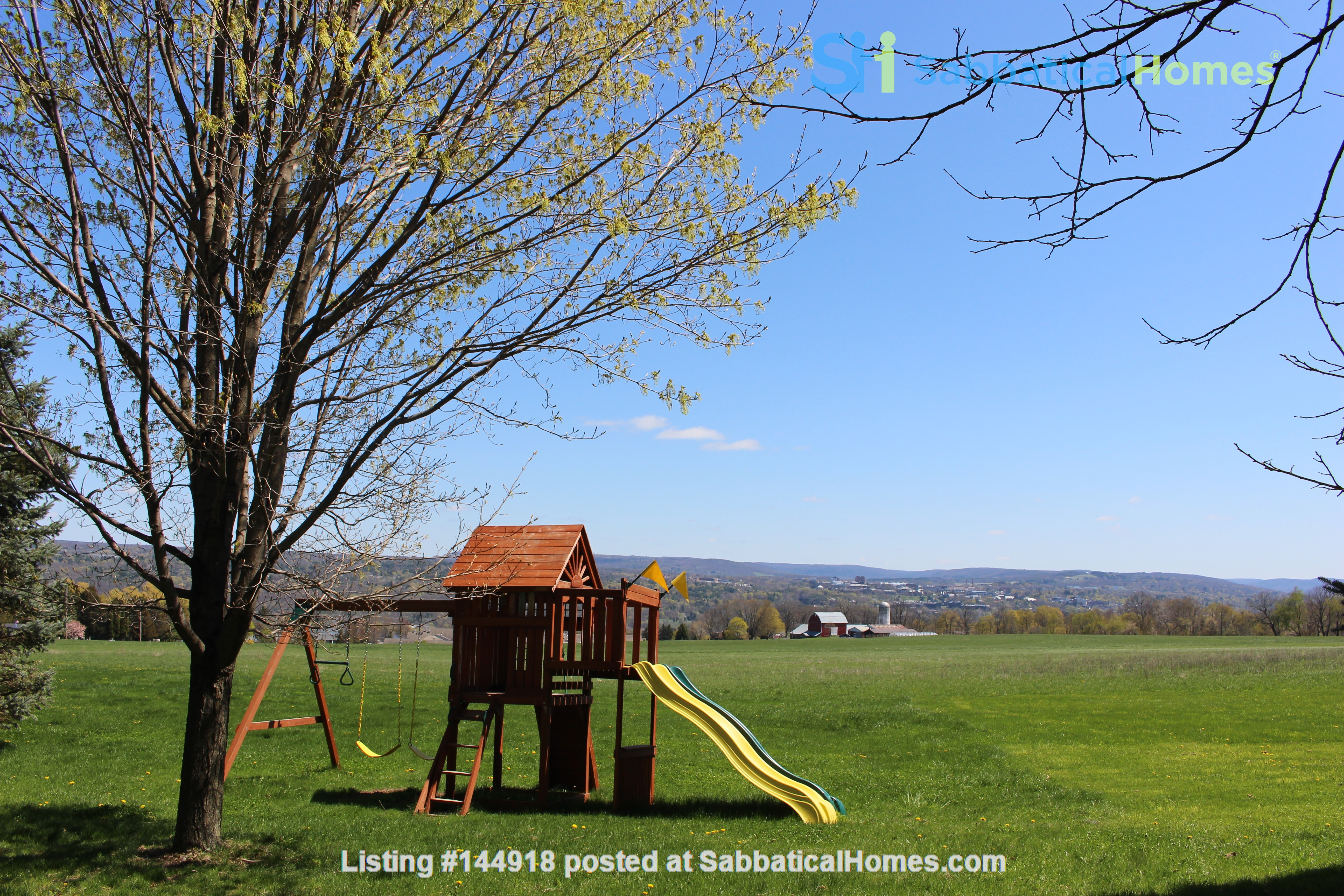 Beautiful FURNISHED large home (5 BDR, 4 BATH)  with in-home gym, playground, expansive views, spacious grounds, Close to both Cayuga Med and Cornell University Home Rental in Ithaca, New York, United States 3