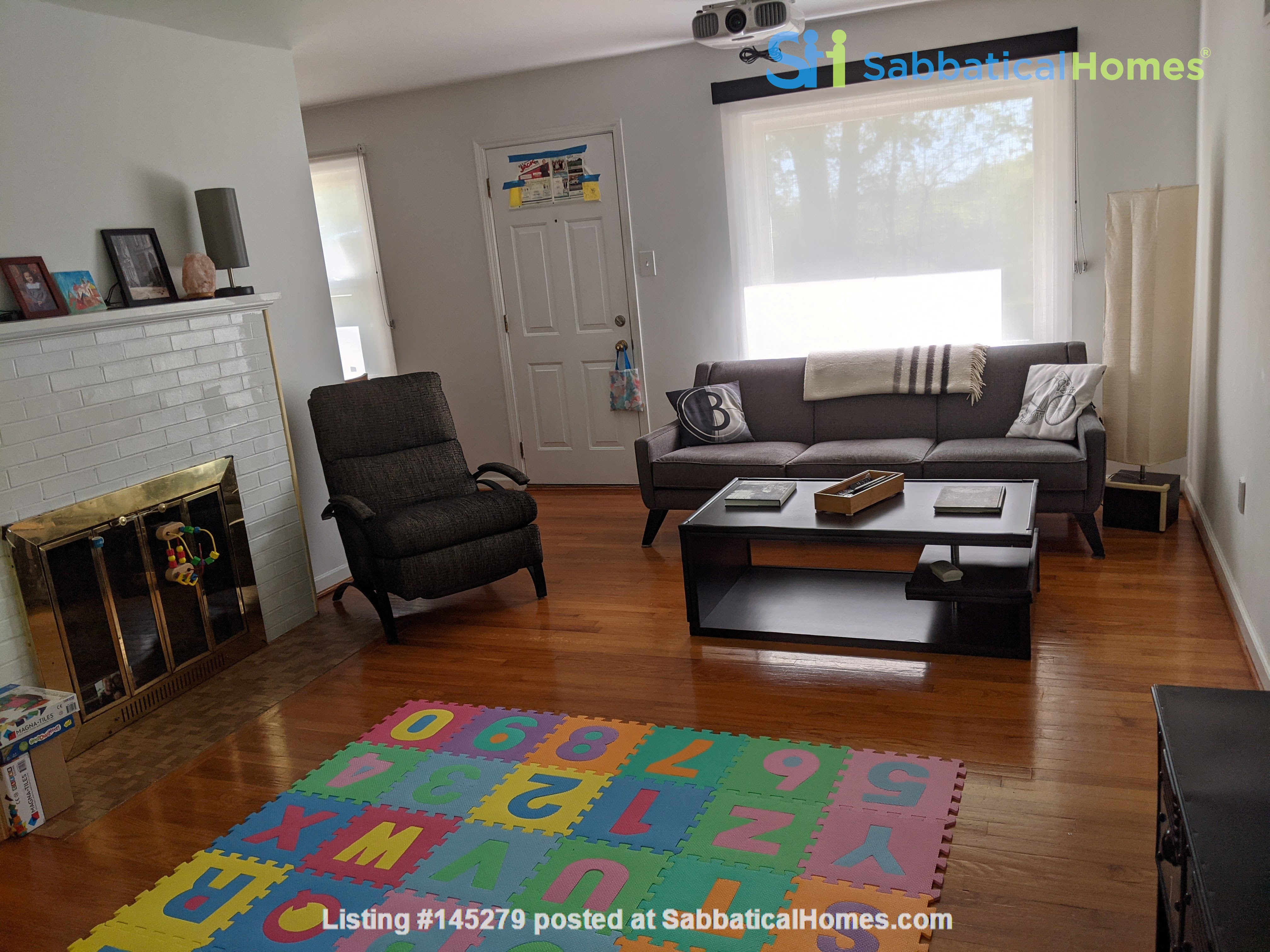 Looking to rent out our little white house on the hill Home Rental in Columbia, Missouri, United States 1