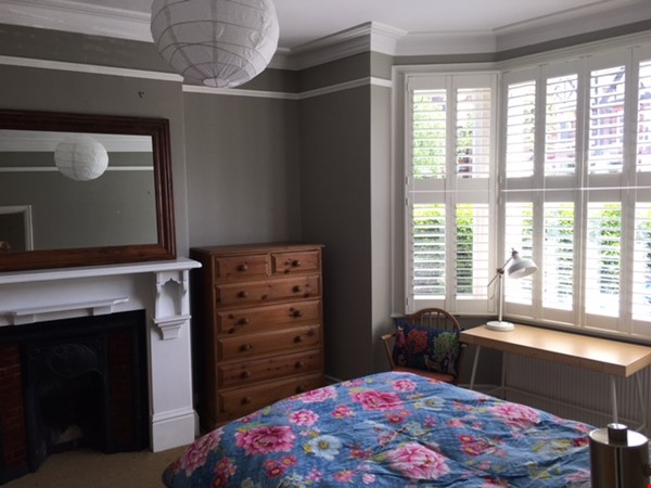 Large bedroom and private bathroom in lovely garden flat in North London Home Rental in  2 - thumbnail