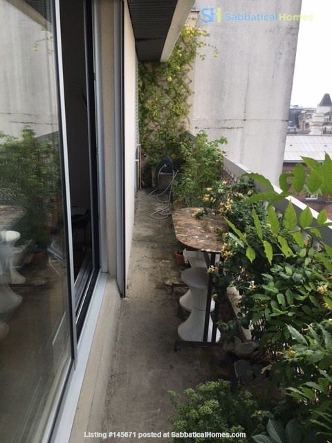 Very large, sunny and quite flat with an amazing view over Paris Home Rental in Paris, Île-de-France, France 0
