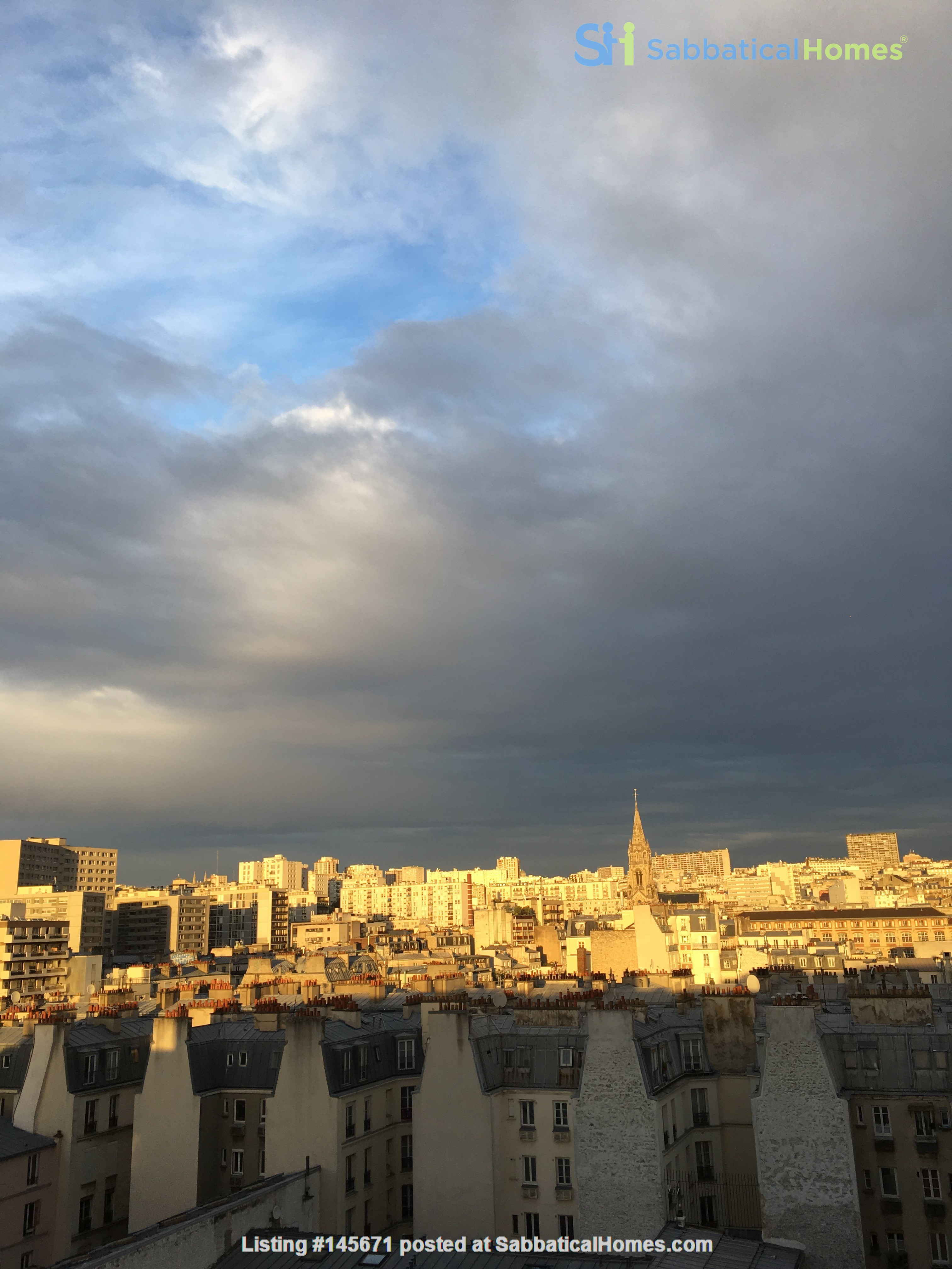 Very large, sunny and quite flat with an amazing view over Paris Home Rental in Paris, Île-de-France, France 1