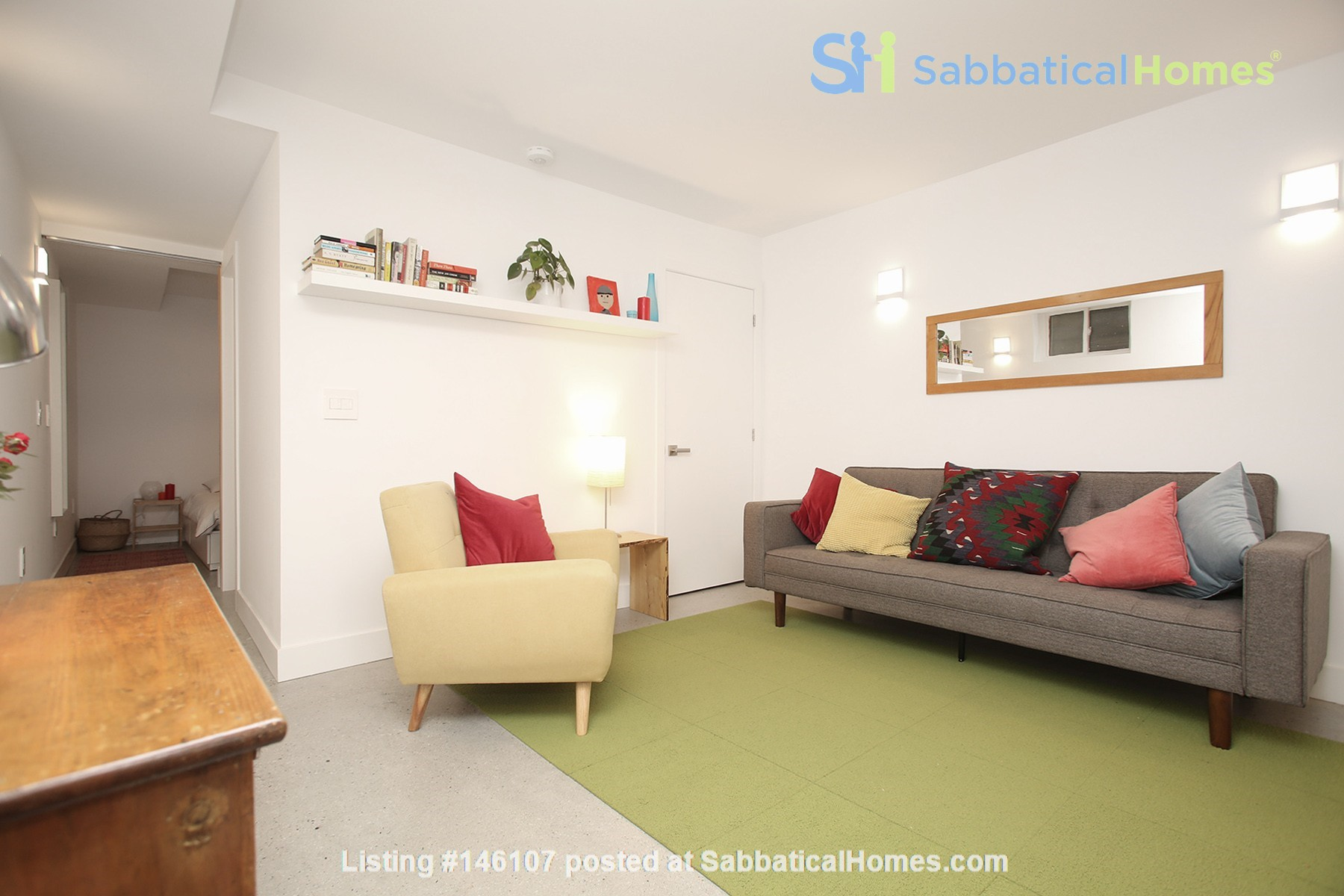 Modern designer space perfect for relaxing and working in! Home Rental in Toronto 3